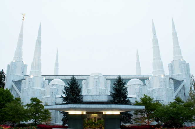 The entrance and side of the Portland Oregon Temple, with a gray sky overhead.