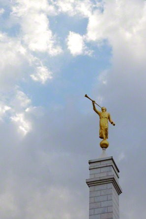 The angel Moroni on top of a gray spire at the Oaxaca, Mexico Temple on a cloudy day.