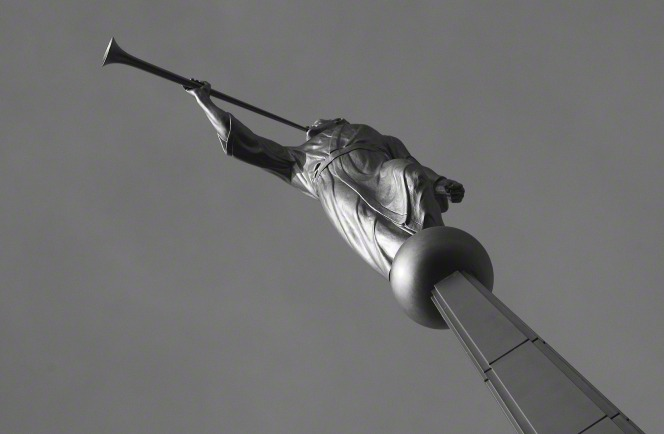 A black-and-white photograph of the angel Moroni statue on the Idaho Falls Idaho Temple, seen from below.