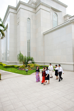 A group of four women and two men walking away from the Guayaquil Ecuador Temple.