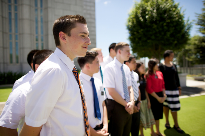 Elder and sister missionaries standing in a line on the grass outside the Cebu City Philippines Temple.