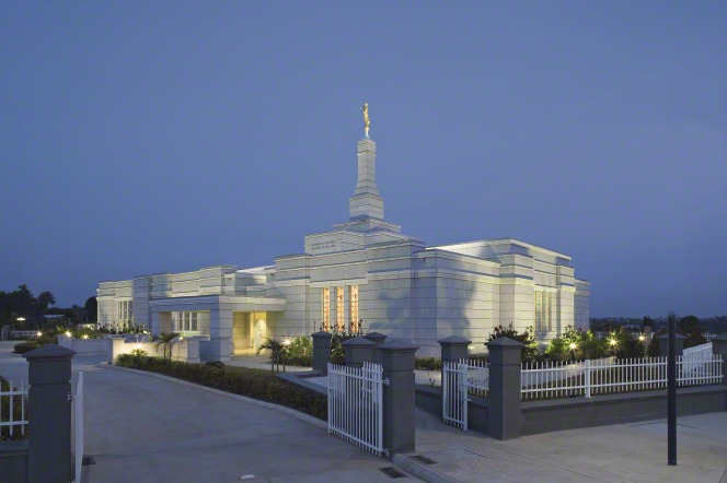 The Aba Nigeria Temple lit up, with the twilight sky in the background.