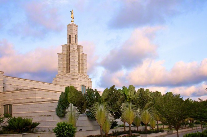 A side view of the Accra Ghana Temple and the trees on the grounds during the early evening hours.
