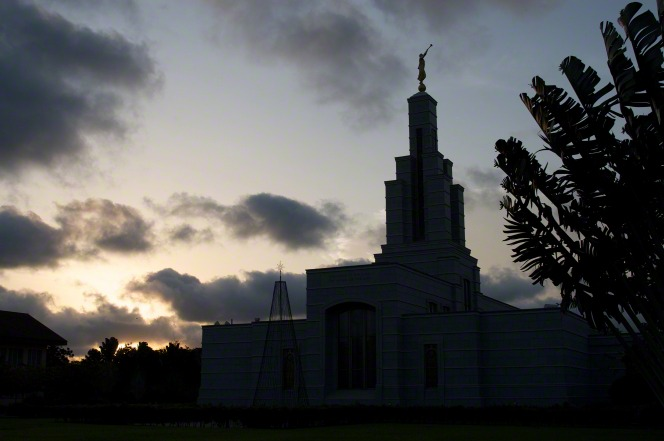 The exterior of the Accra Ghana Temple silhouetted in the late evening.