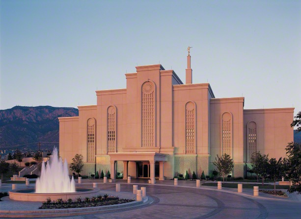 A view from the front of the Albuquerque New Mexico Temple and the water fountain in the early evening, just after the lights have come on.