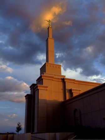 The spire on the Albuquerque New Mexico Temple, with the statue of the angel Moroni seen in the light of the sunset.