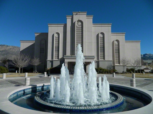 A wide-angle photograph of the water fountain in front of the Albuquerque New Mexico Temple, with the temple seen in the background.
