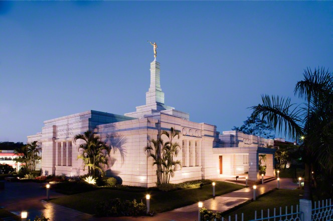 A view of the Asunción Paraguay Temple in the evening, with the temple and the grounds illuminated by the lights.