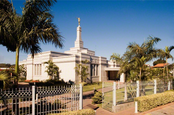 A daytime photograph of the Asunción Paraguay Temple, with the gate open on the surrounding fence.