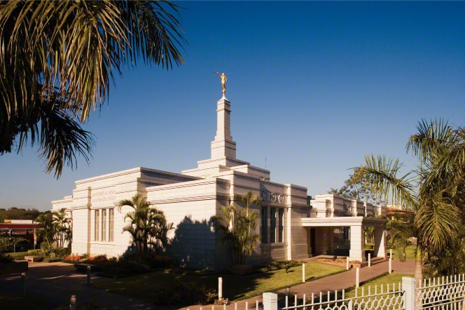 The Asunción Paraguay Temple and the palm trees on the grounds in the daytime.