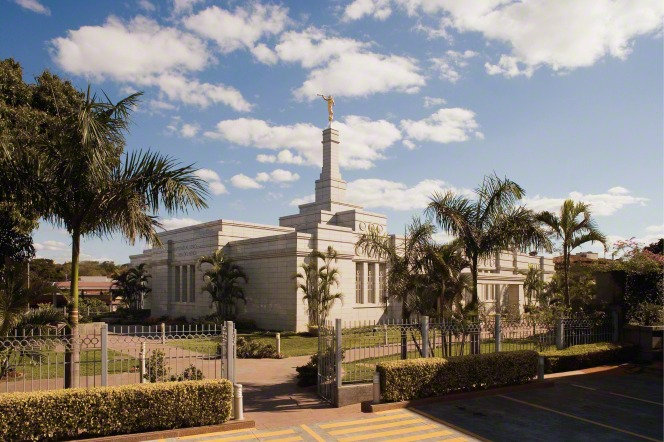 A view of the Asunción Paraguay Temple during the daytime, with the gate open to the grounds.