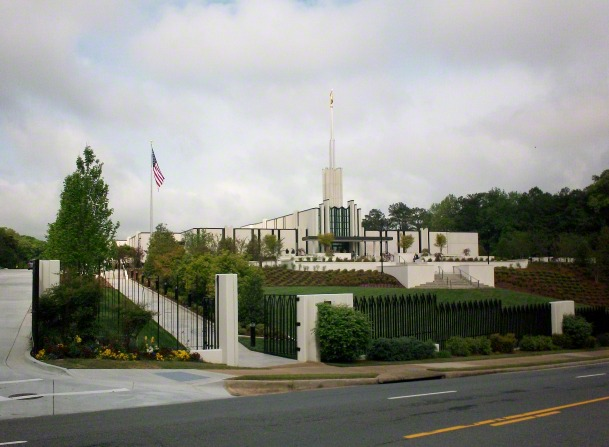 A view of the Atlanta Georgia Temple and the full temple grounds from across the street during the day.