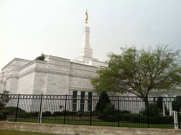 A view of one of the sides of the Baton Rouge Louisiana Temple, with a green tree next to the temple's fence.