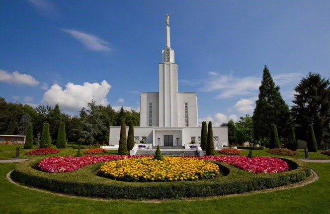 A large, well-kept flower bed with the Bern Switzerland Temple in the background.