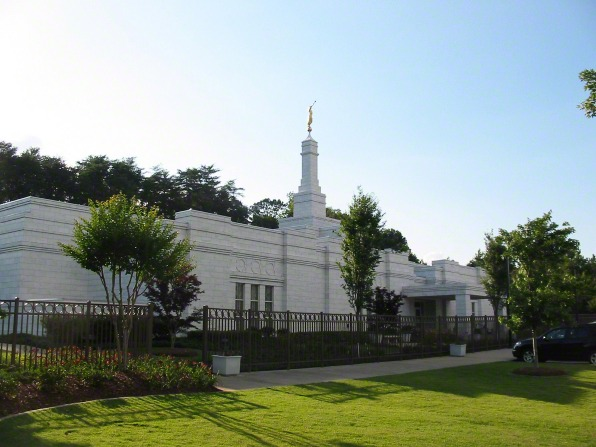 A side view of the Birmingham Alabama Temple on a sunny day, with green lawns on the temple's grounds.