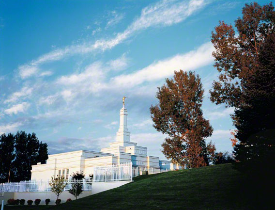 The Bismarck North Dakota Temple, seen beyond a green hill.