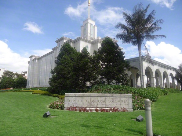 The Bogotá Colombia Temple seen from the bottom of a hill, with the temple's granite sign in view.