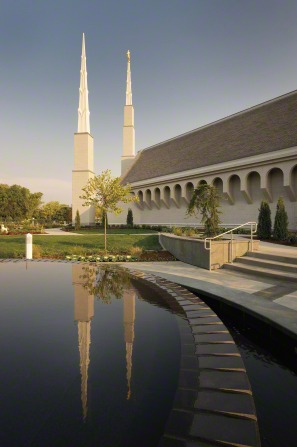 A pond on the grounds of the Boise Idaho Temple, with the temple's spires reflected in the water.