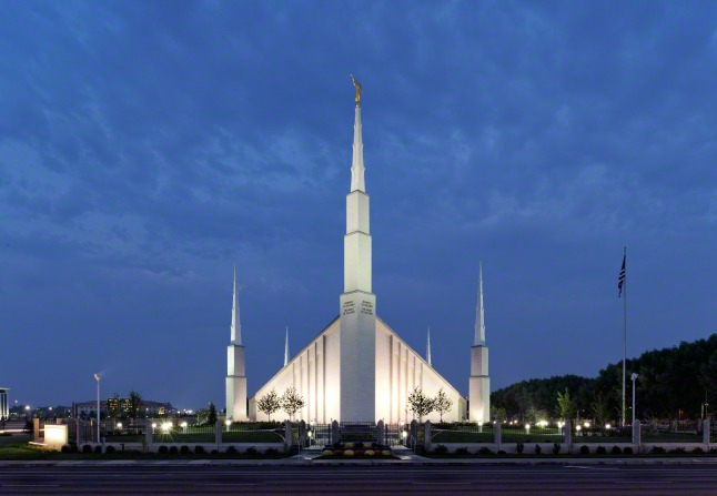The Boise Idaho Temple as seen from across the street late in the evening after the lights have come on.