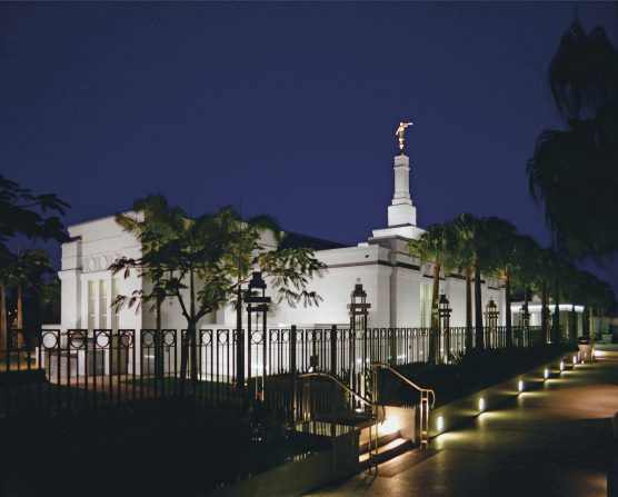 The Brisbane Australia Temple lit up against a deep purple night sky.
