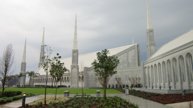 A side view of the Buenos Aires Argentina Temple, with small trees growing on the grounds.