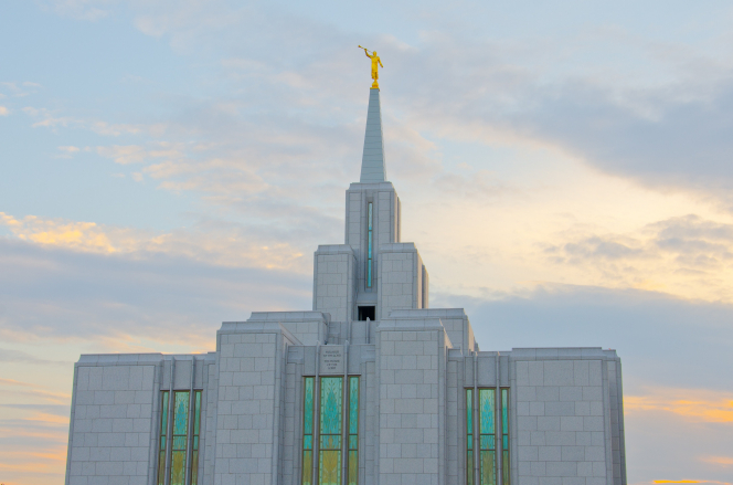 The stained glass and the spire on the Calgary Alberta Temple in the daytime.