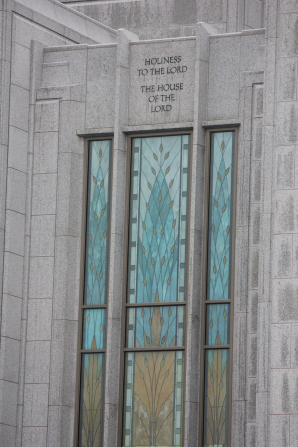 "The stained glass on the Calgary Alberta Temple, with the inscription ""Holiness to the Lord: The House of the Lord"" on the stone above the window."