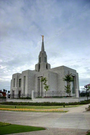 A view of the entire Cebu City Philippines Temple, with some roads and the front lawns in the foreground.