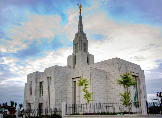 A front view of the Cebu City Philippines Temple, with a black iron fence surrounding the grounds.