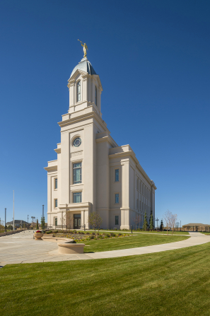 The exterior of the Cedar City Utah Temple against a blue sky.