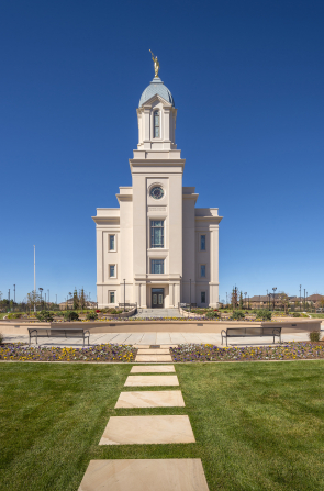 The exterior of the Cedar City Utah Temple, showing the grounds and the path leading up to the front entrance.