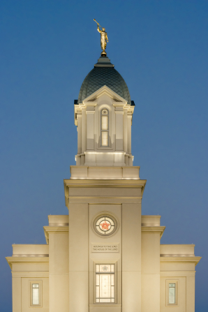 A photograph of the Cedar City Utah Temple steeple in the late evening.