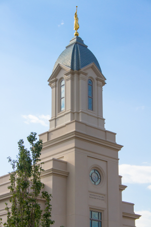 A photograph of the Cedar City Utah Temple steeple topped with a statue of the angel Moroni.