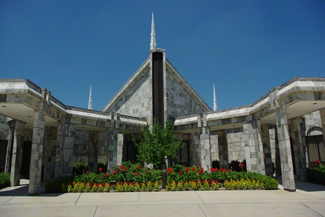 A close-up view of the entrance to the Chicago Illinois Temple, with the flower beds in full bloom.