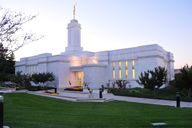 The Colonia Juárez Chihuahua Mexico Temple in the evening, with the windows lit up and the lawn freshly mowed.