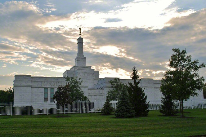 The Columbus Ohio Temple in the early evening, with the temple's white fence encompassing the borders of the temple grounds.