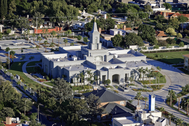 An aerial view of the Córdoba Argentina Temple and the surrounding neighborhood during the daytime.