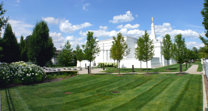 A freshly mowed lawn on the grounds of the Detroit Michigan Temple, with the temple seen in the background.
