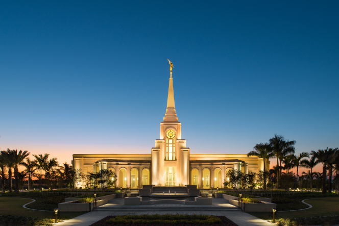 The front of the Fort Lauderdale Florida Temple lit up from without and within, just after sunset.