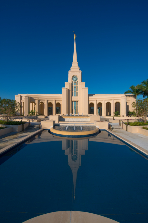 A view of the front entrance to the Fort Lauderdale Florida Temple, with a reflecting pool on the temple grounds.