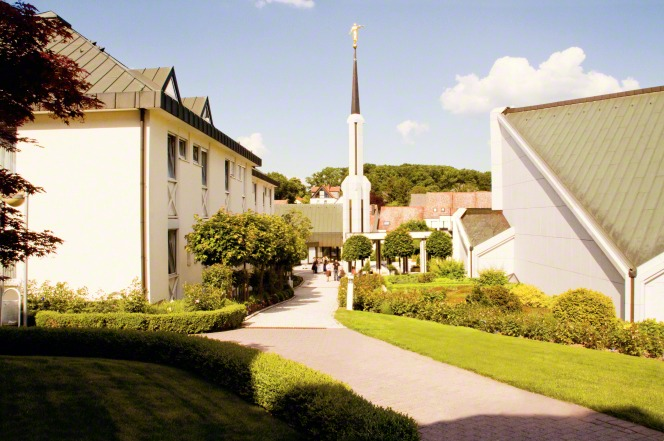 A back view of the Frankfurt Germany Temple on a sunny day, with another building seen on the left.