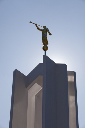 A detail shot of the Freiberg Germany Temple and angel Moroni, with a clear sky in the background.