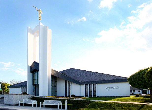 A front side view of the Freiberg Germany Temple, with the angel Moroni on top of the spire to the left.