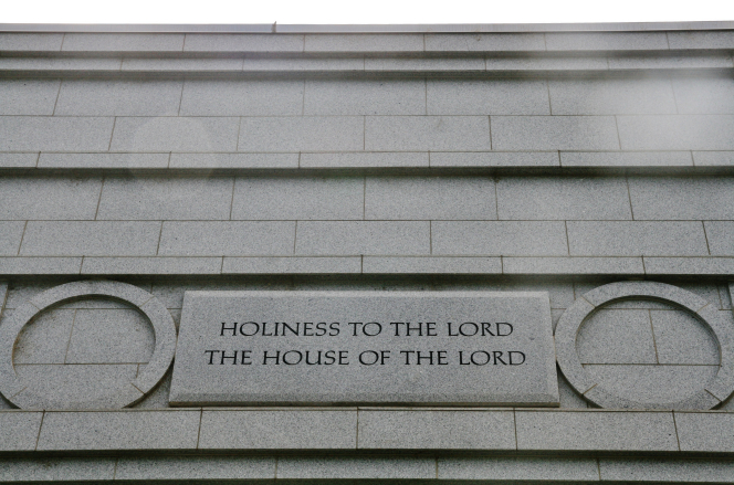 "A detail from the Fresno California Temple, with the words ""Holiness to the Lord: The House of the Lord"" etched in the granite between two rings."