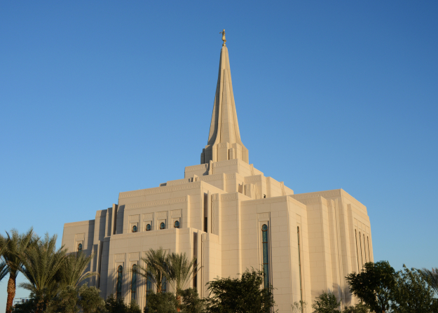 A daytime view of the Gilbert Arizona Temple, with a clear blue sky in the background.