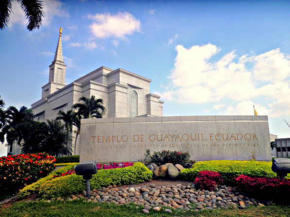 The name sign of the Guayaquil Ecuador Temple surrounded by flowers, rocks, and bushes.