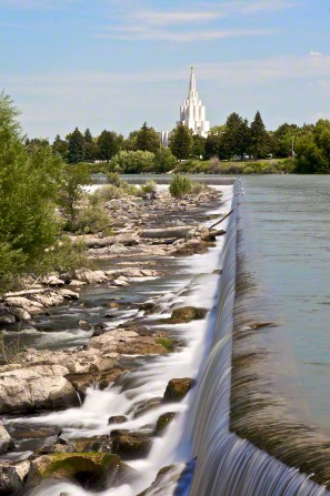 The waterfalls near the Idaho Falls Idaho Temple, with the temple seen in the distance.