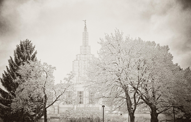 An artistic interpretation of the Idaho Falls Idaho Temple in the snow during the winter, including snow-covered trees on the grounds.