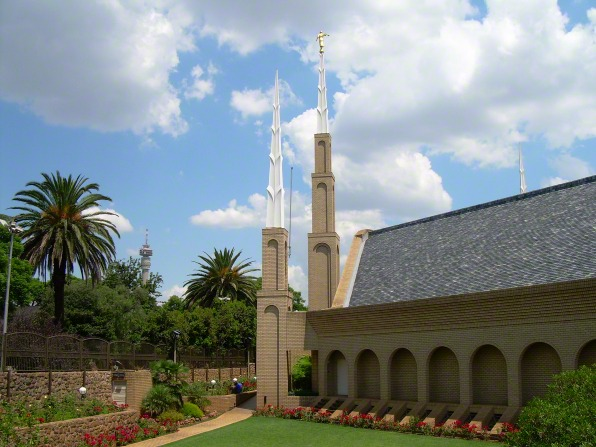 Several spires on the Johannesburg South Africa Temple, with local trees and other vegetation on the left side.