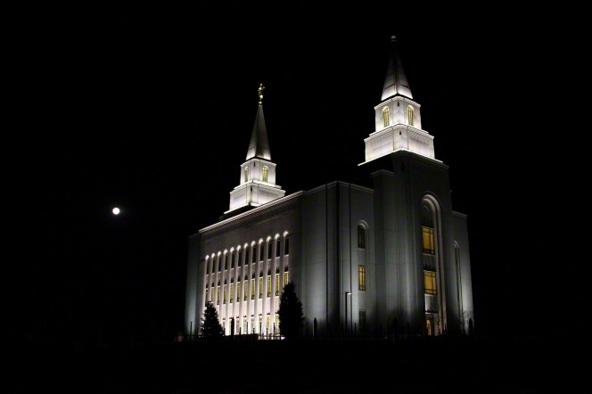 The Kansas City Missouri Temple after dark, glowing with the lights on the spires and within the windows.